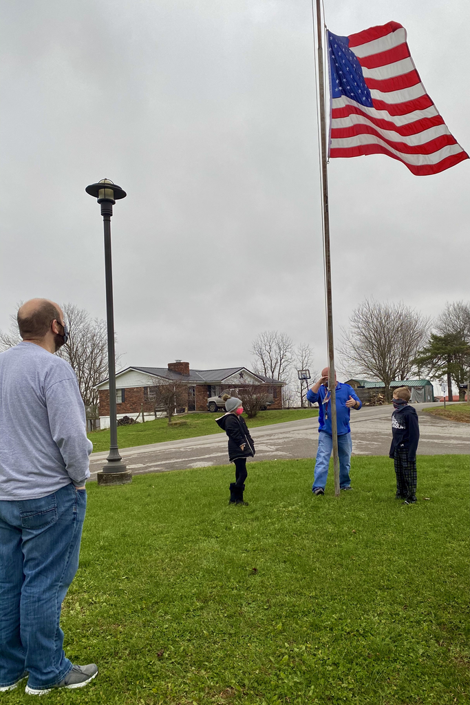 Lowering the flag to half staff