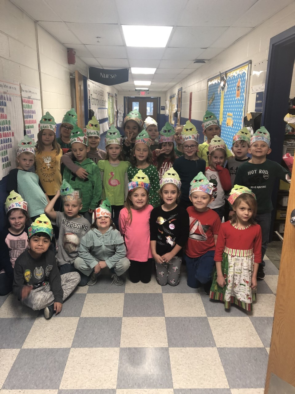K/1 Students in Grinch hats at Christmas